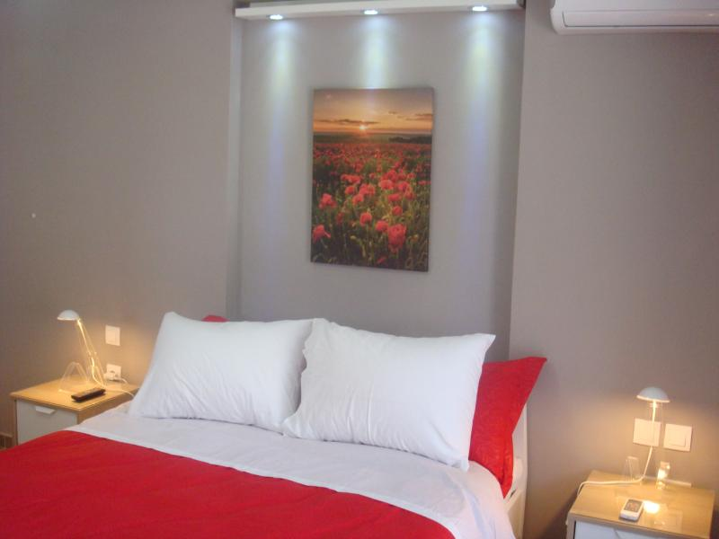 Spotlights give character to the master bedroom