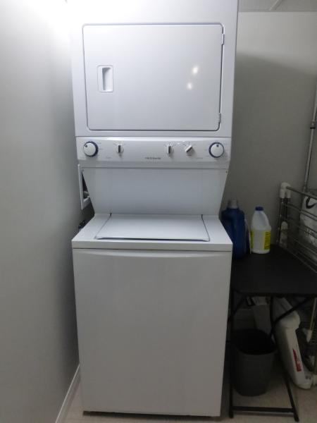 In suite laundry with detergent, bleach, and a hanging rack. There is steamer to 'iron', as well.