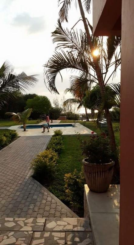 The sunsets and sunrises are blessed. House with view to the garden, pool and ocean