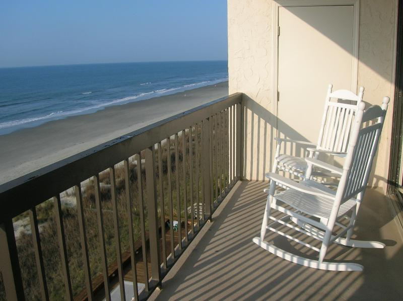 Balcony with rocking chairs