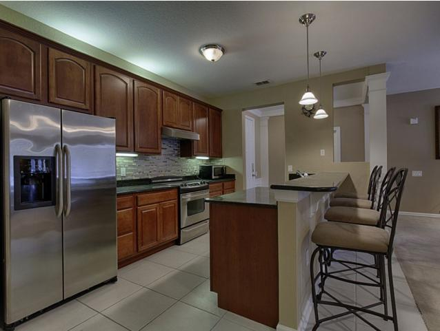 Kitchen. With all set cooking utensils.
