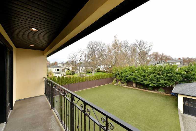 Master bedroom balcony overlooks the backyard.