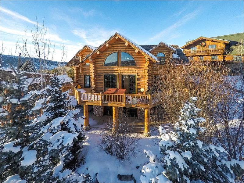 Exterior of this 3-Level, Custom Log Home with wraparound deck and patio.