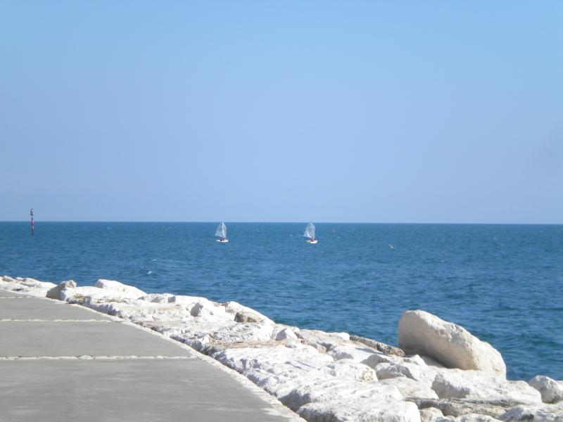 Children sailing seen from the Caposele's harbour pier