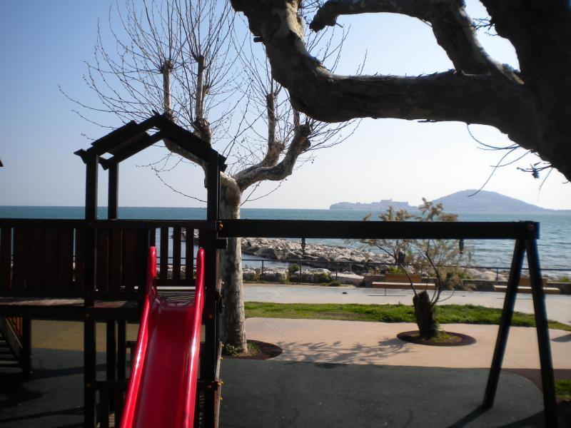 Children's playground in Vindicio's pinewood, view on Gaeta