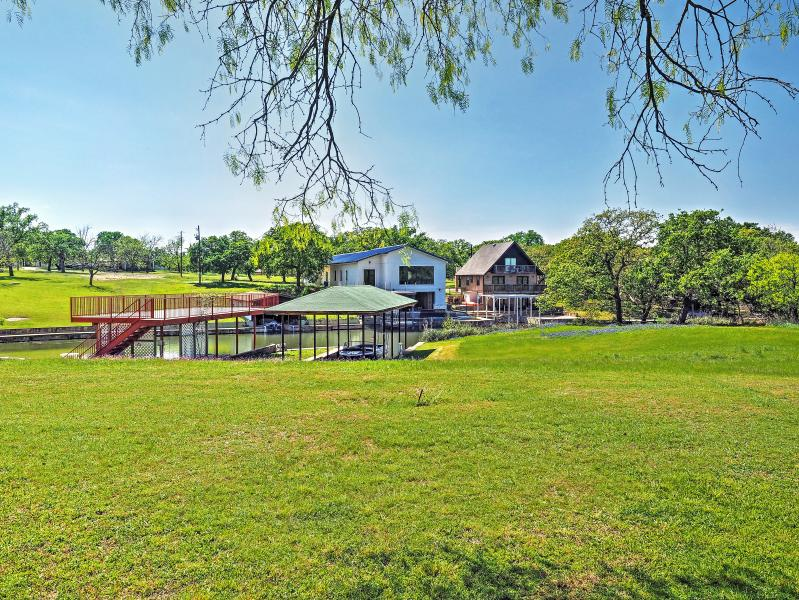 This lakefront home sits on 1 private acre of land.