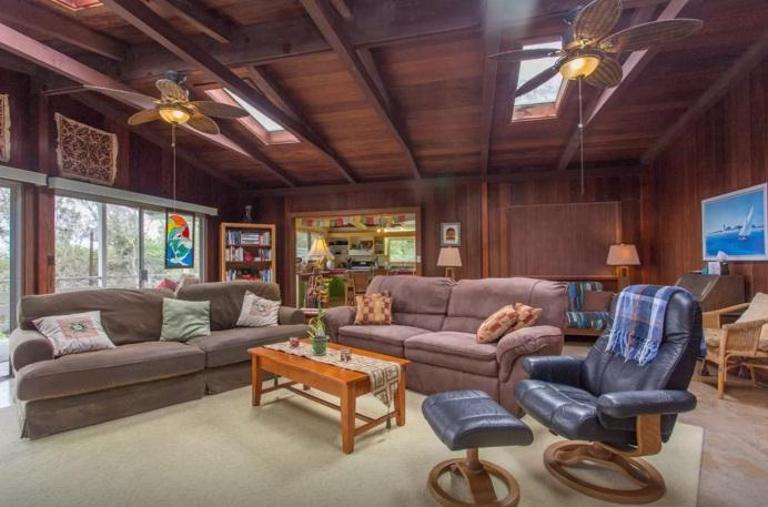 24x24 spacious living room with 4 skylights. lanai and kitchen in background