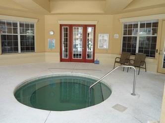 Hot tub adjacent to pool