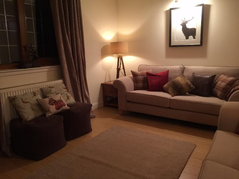 Cosy lounge with new sofas and soft furnishings