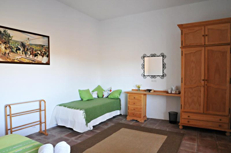 Both downstairs bedrooms  also have a single bed