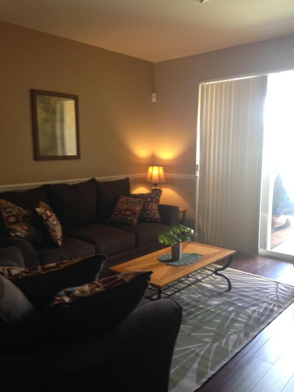 Living room opens onto screened patio area