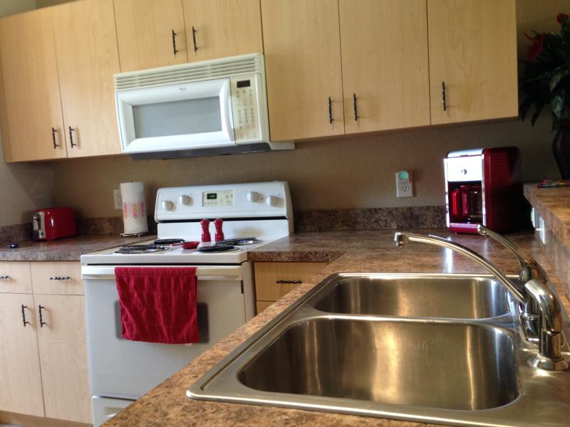 Fully stocked Kitchen. Fridge with Ice Maker, Stove, Microwave, Dishwasher, Coffee Maker, Toaster