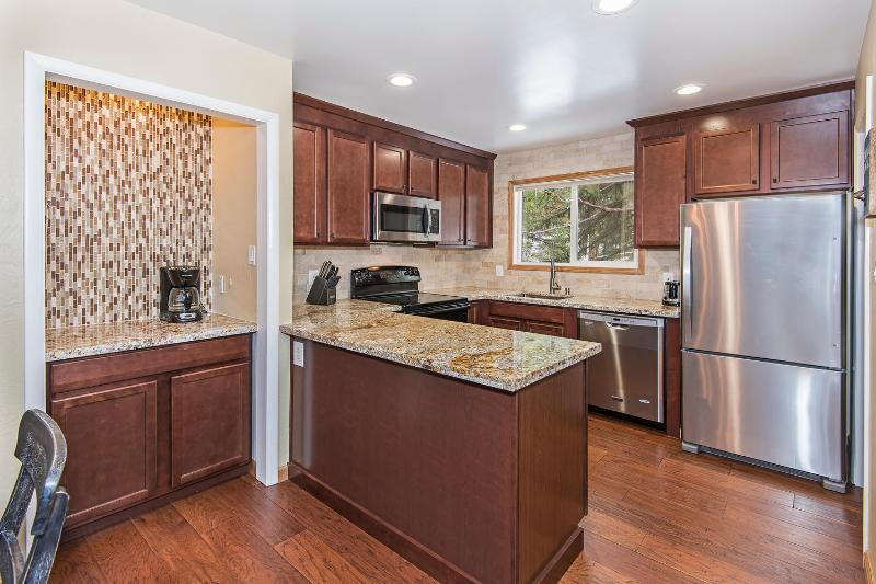 Newly remodeled kitchen and coffee bar. Fully stocked including coffee, cream, sugar and tea
