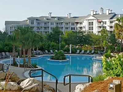 lagoon pool with two hot tubs and a children's pool