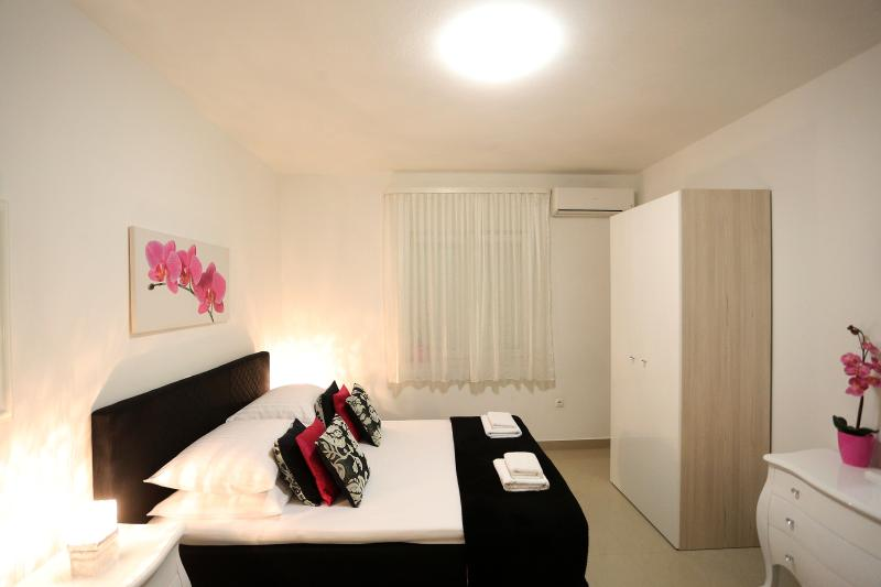 Bedroom with a TV and aircon