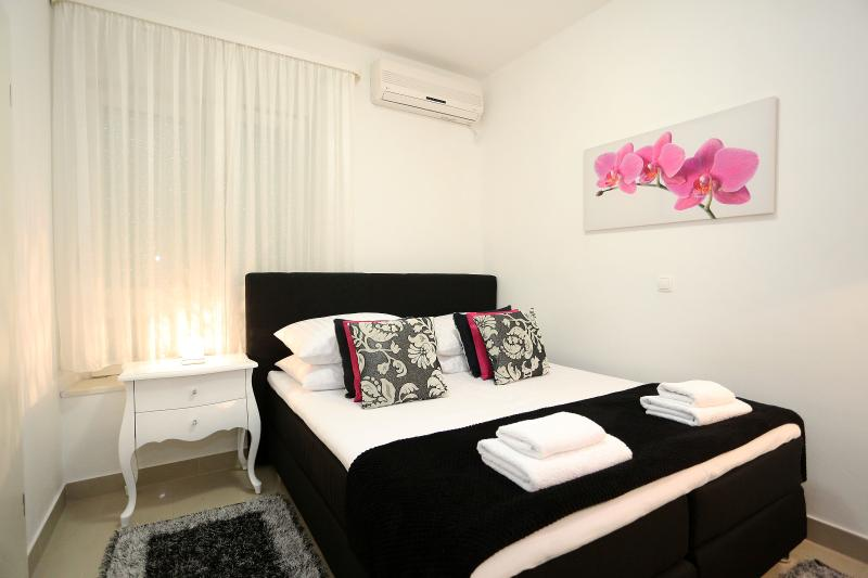 Bedroom with TV and aircon