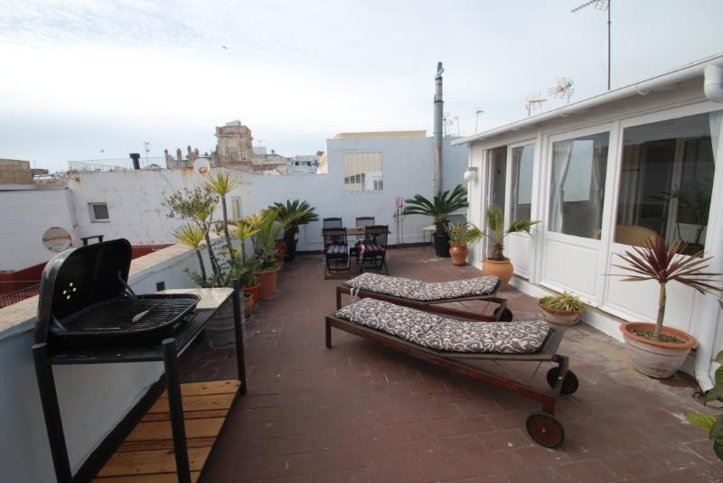 terrace with bilk chairs and charcoal barbeque
