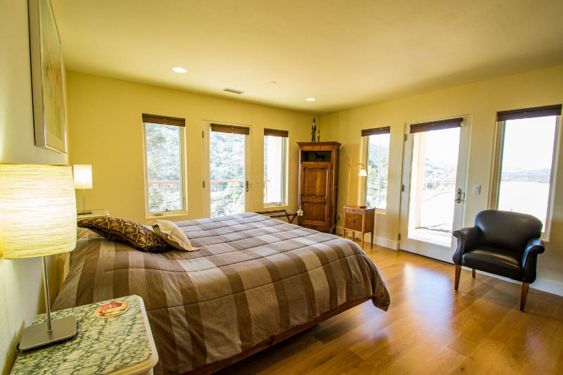 Second guest bedroom with its own private bathroom, entrance to  deck.