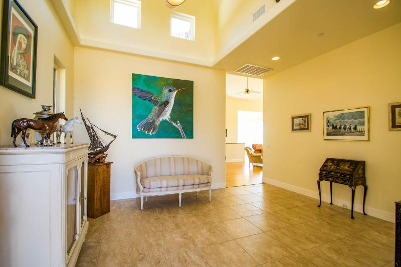 Our entrance with our amazing hummingbird painting.