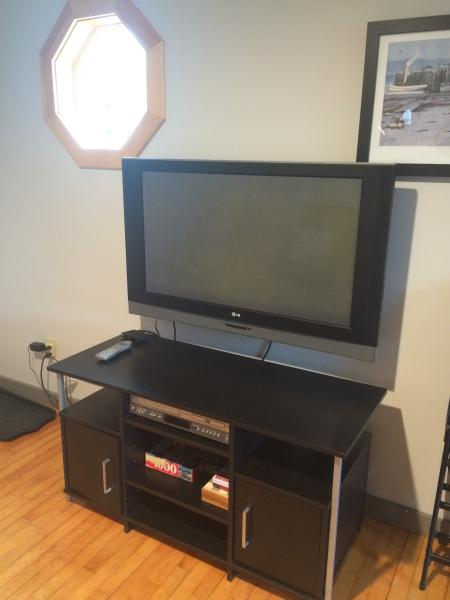 Large flat screen TV.  DVD/VCR player.  20 channel basic cable.