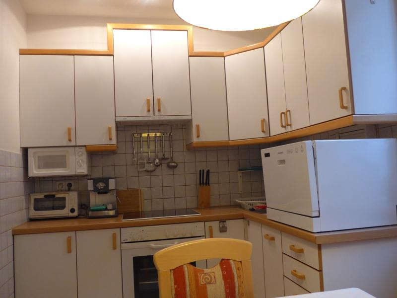 Kitchen with stove, oven, microwave, dishwasher, coffee maker, fridge