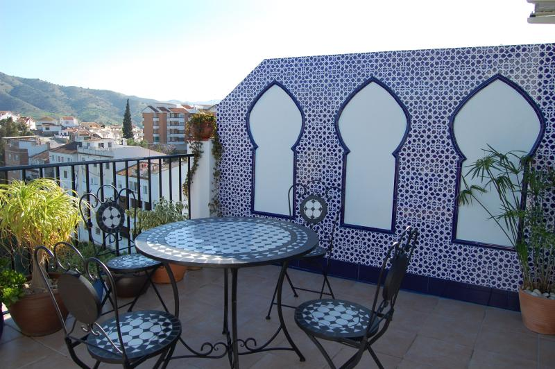 The terrace with panoramic views of the town, the countryside and the mountains.