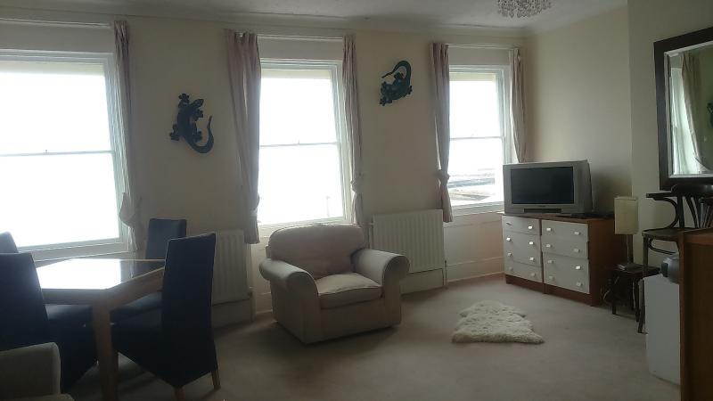 Large living area with fantastic sea views and double sofa bed also in this room