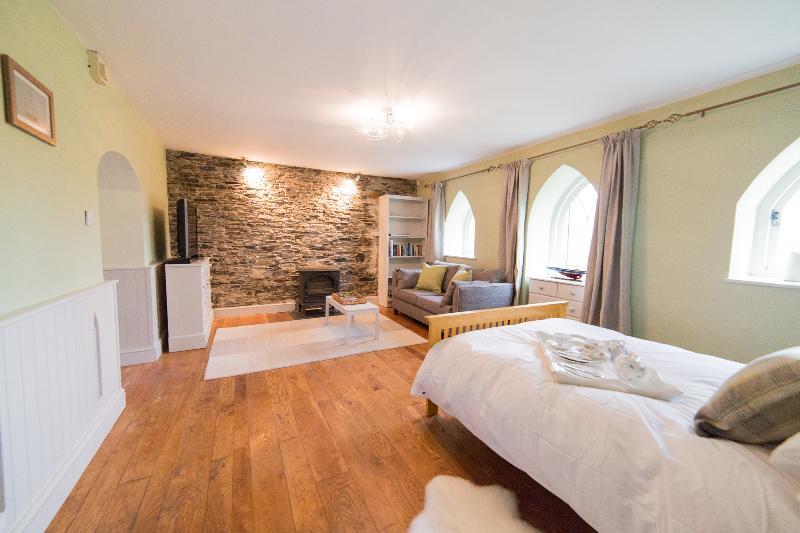 Living / sleeping room showing wood burner