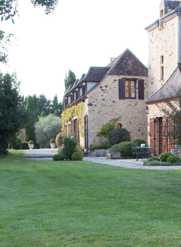 The guest house starts just after the tower which is in the owners' residence