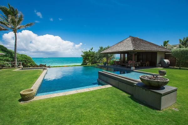 Enjoy panoramic views of the ocean while swimming in the infinity pool.