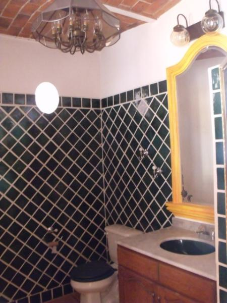 Bathroom with dark green tile.