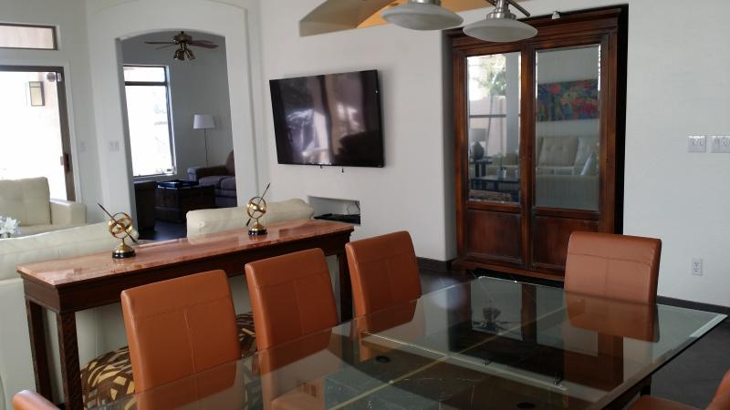 Glass/marble DR table seats 8, Den with 2 loveseats and desk, LR w/ 70' SmartTV, Covered priv. patio