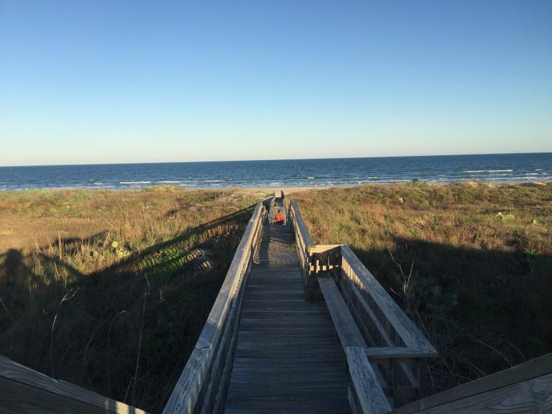 Boardwalk to the beach with is a 5 minute walk max from our house!