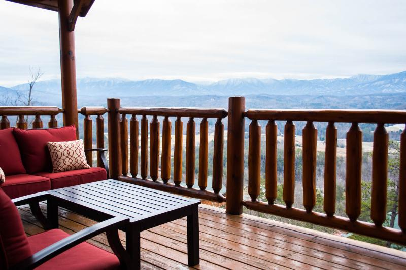 Deck with cushioned patio furniture to enjoy the view