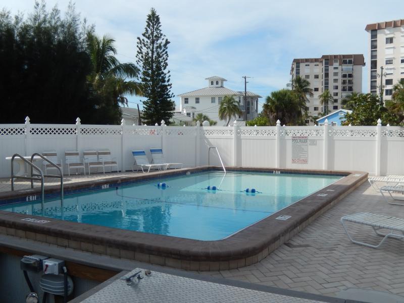 Very Nice Pool Area with Lounge Chairs