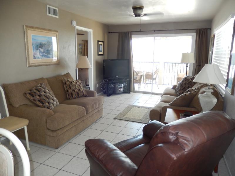 Living Room with Sleeper Sofa, Love Seat, Recliner, HD TV.