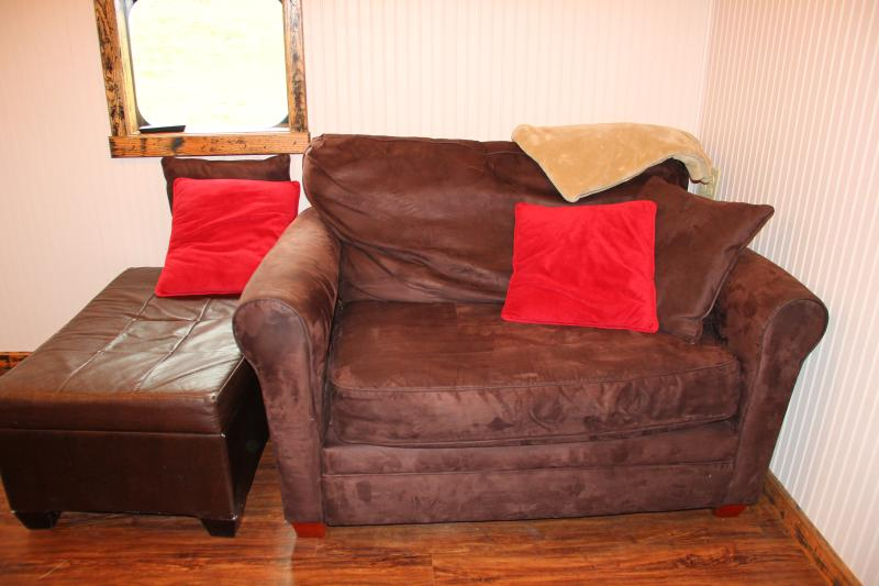 Comfy oversize couch in common area
