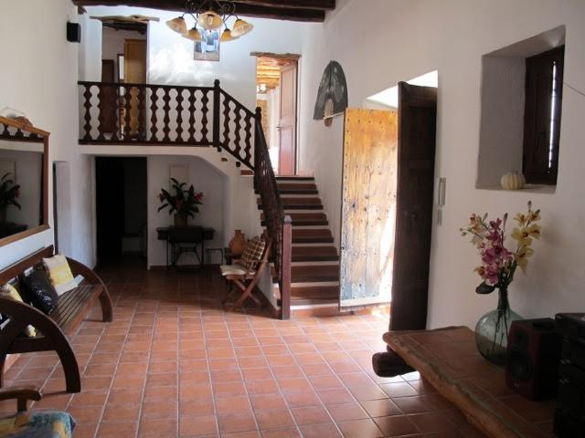 The main hall way with its original solid wood doors and high ceilings