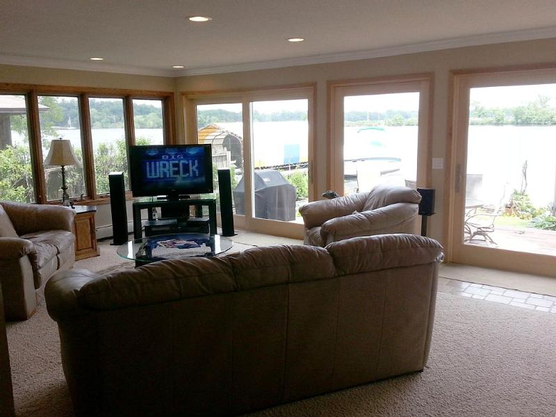 Living Room with 55' Flat Screen TV (X1 Xfinity system - restart/save/forward Movies selection) DVD,