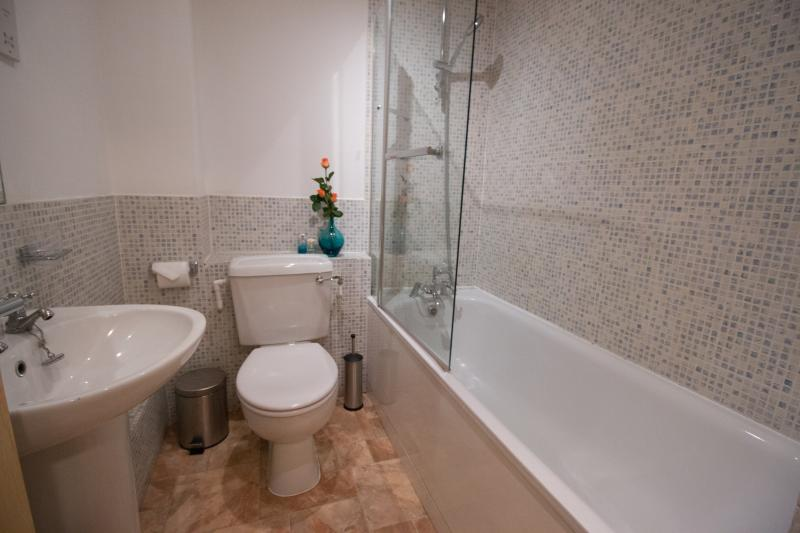 Sedate and soothing decor in a Monument Apartments bathroom.