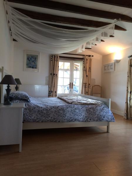 Upper Schoolhouse superking bedroom with door opening to the veranda