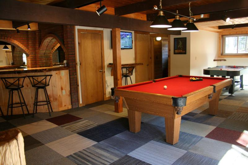 Off of the game room are (left to right) laundry room, full bathroom and sauna.