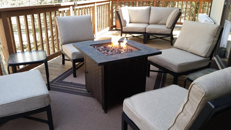 New outdoor cushioned furniture and propane firepit.