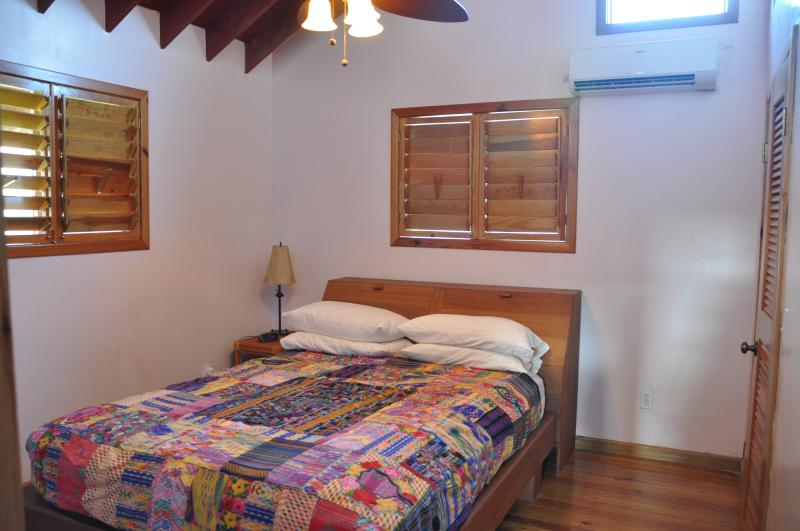 Bedroom #1  with queen bed and private bathroom in Upper Reef Villa
