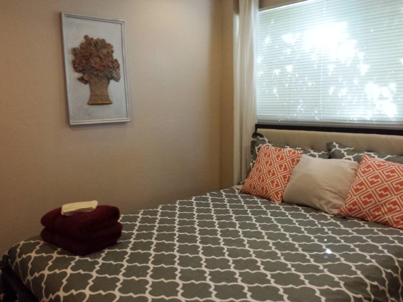 Bedroom with new Simmons Beauty Rest queen mattress.