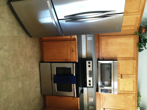 Bright kitchen with upgraded stainless steel whirlpool appliances