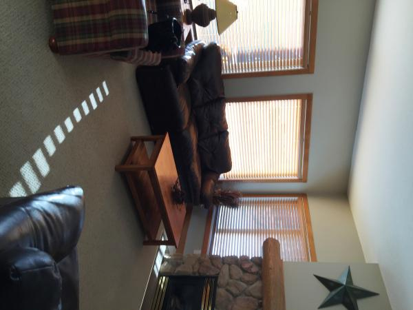 Living room - bright windows.  Gas fireplace.  TV, cable, WIFI, reading materials, games
