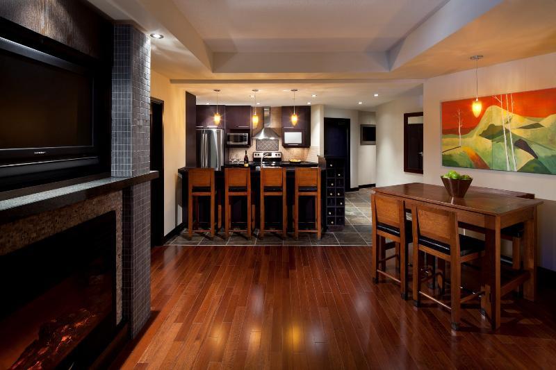 The condo has an open-concept floor plan