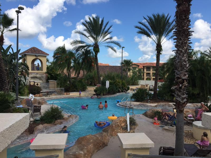 Large pool area includes lazy river, water slide and zero entry.