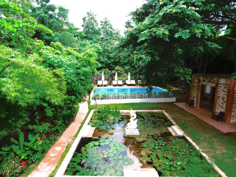 An overall view of the garden in front of the main building ensures you a relaxing holiday retreat.